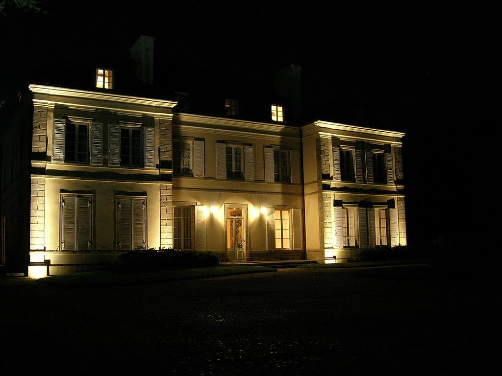 The chateau, floodlit at night