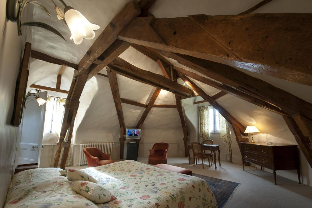 Large attic room with beamed ceiling