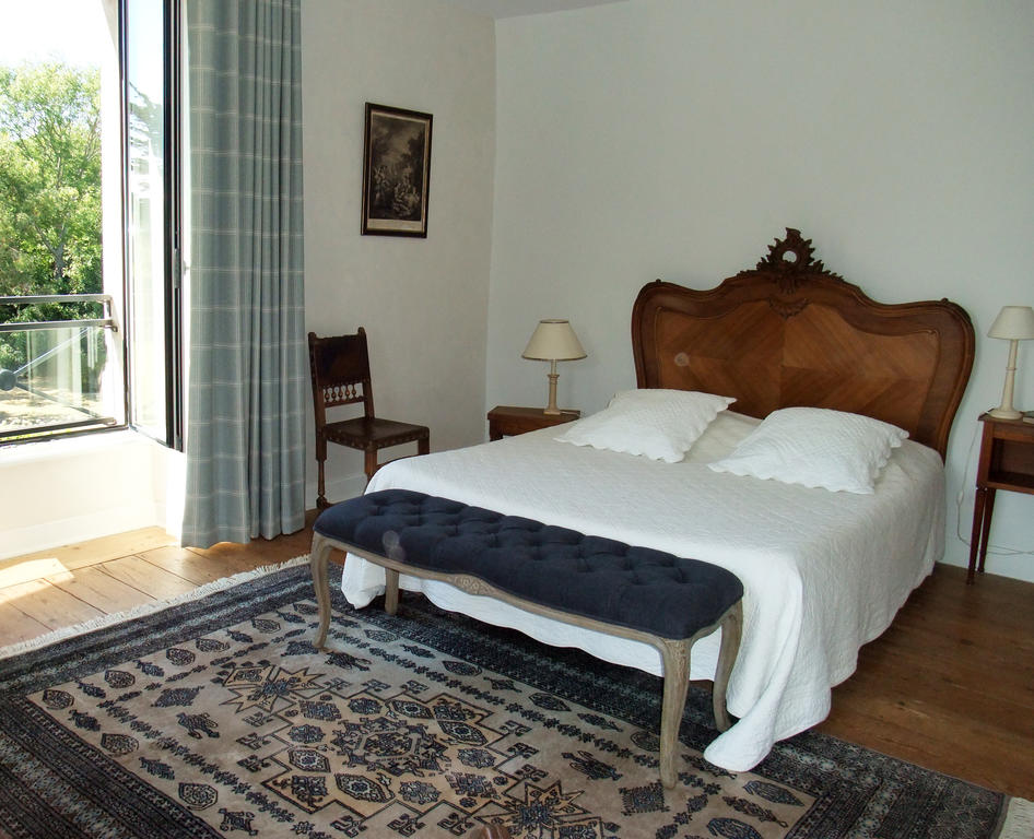 Double bed with antique bedhead