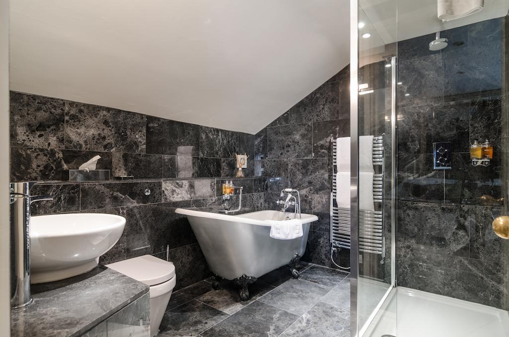 Bathroom with black marble walls