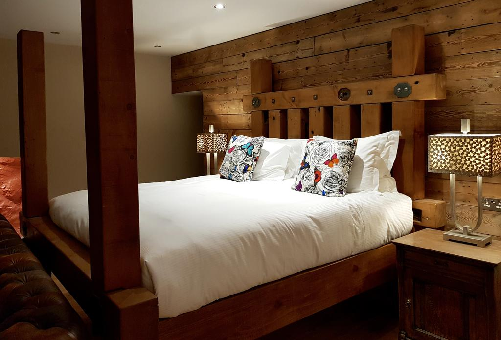 Kingsize bed of reclaimed timber