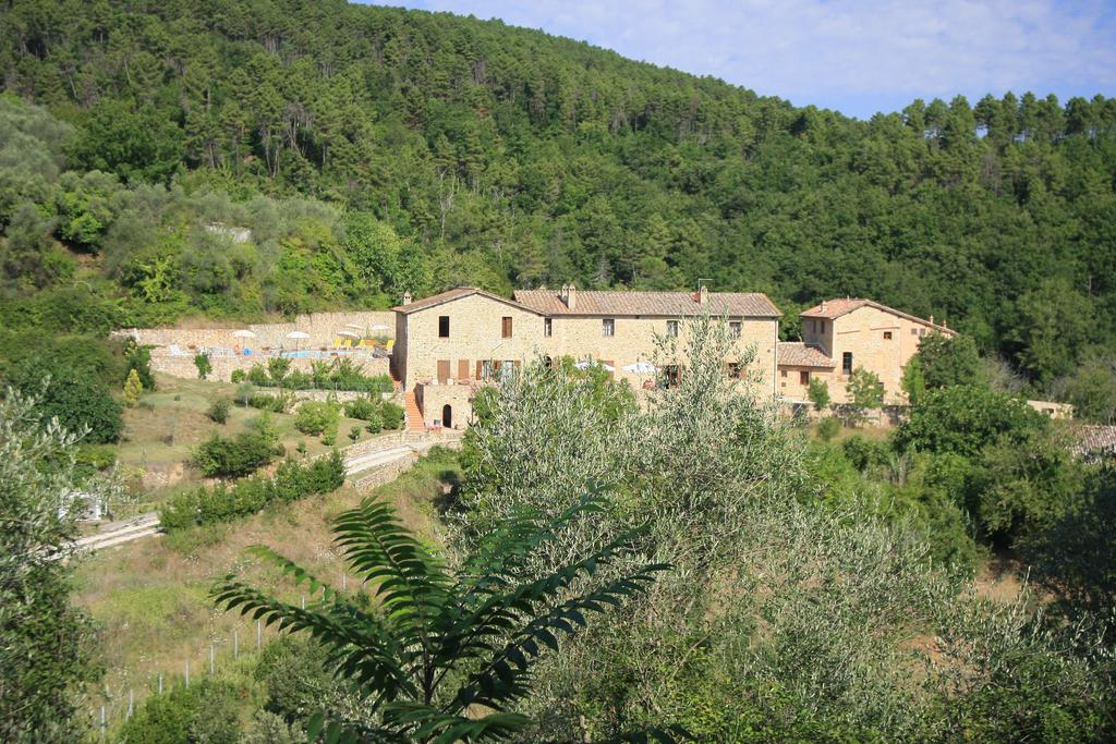 Small Tuscany hotel surrounded by trees and fields