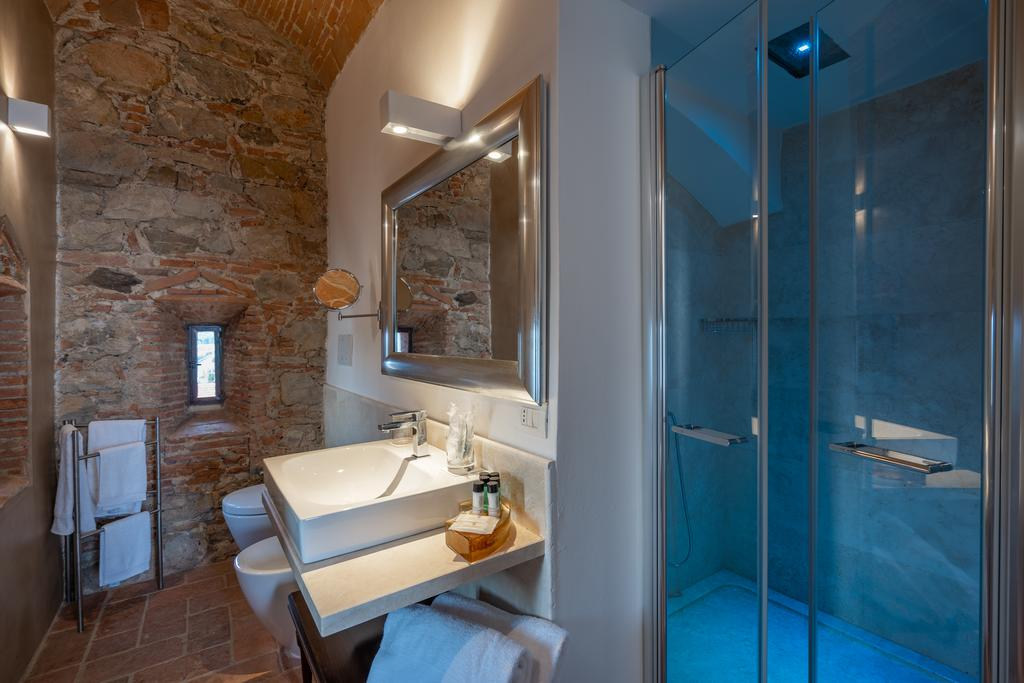 Shower room with exposed stone wall